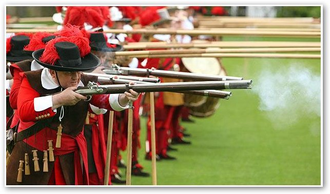 Musketeers-fire-matchlocks-with-pikemen-looking-on1.jpg